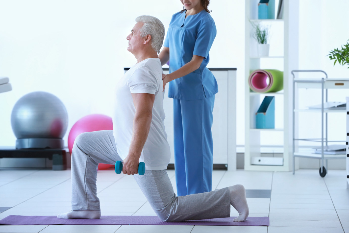 Physical therapist helping osteoporosis patient